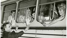 NDP hopeful David Lewis greets bus riders in 1962.
