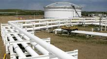 Pipelines feed crude oil into in the tank farm at the Enbridge Pipelines oil terminal facility in Hardisty, Alta (Larry MacDougal/Larry MacDougal/CP)