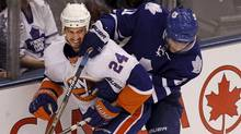 New York Islander Radek Martinek and Toronto Maple Leaf Fredrik Sjostrom get tangled up as the fight for the puck during first period NHL action Oct 18, 2010 in Toronto. (Moe Doiron/The Globe and Mail) (Moe Doiron/Moe Doiron/The Globe and Mail)