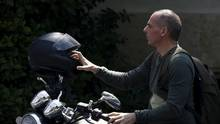 An avid motorcyclist, Yanis Varoufakis arrives on at Maximos Mansion to attend a meeting with Prime Minister Alexis Tsipras in Athens in May, 2015. (Kostas Tsironis/REUTERS)