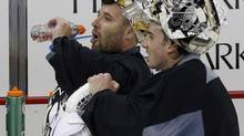 Pittsburgh Penguins goalies Marc-Andre Fleury, right, and newly acquired backup Tomas Vokoun take a break during an NHL hockey practice at the Consol Energy Center in Pittsburgh Monday, Jan. 14, 2013. (Gene J. Puskar/AP)