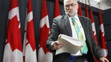 Auditor-General Michael Ferguson Tuesday called on the Finance Department to produce reports for both federal and provincial finances showing the state of Canada's public finances as a whole. (CHRIS WATTIE/REUTERS)