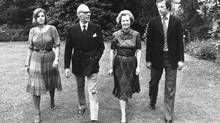 Margaret Thatcher takes a stroll through the grounds of Scotney Castle in Kent, England, where she is a tenant of a National Trust flat, with her husband, Denis, Mark and Carol in March, 1979. (AP)