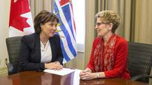 Ontario Premier Kathleen Wynne (right) meets with B.C. Premier Christy Clark at the Queen's Park Legislature in Toronto on Monday, Dec. 8 2014. (Chris Young/THE CANADIAN PRESS)