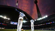 Blue Jays Edwin Encarnacion and Jose Bautista warm up during a recent game against the Los Angeles Dodgers at Rogers Centre in Toronto: The good news is general manager Alex Anthopoulos and team president Paul Beeston have shown they can get money from ownership. (MARK BLINCH/REUTERS)