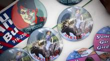 Sarah Palin buttons are displayed for sale outside the Safari Club International Convention in Reno, Nevada January 29, 2011. (MAX WHITTAKER/REUTERS/MAX WHITTAKER/REUTERS)