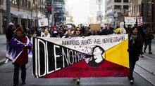 Protesters take part in the Idle No More demonstration in Toronto on Jan. 16, 2013. (MARK BLINCH/REUTERS)