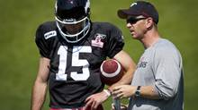 Calgary of Stampeders' offensive coordinator Dave Dickenson, right,  instructs quarterback Brad Brad Sinopoli during a practice in Calgary, Alta., Monday, June 27, 2011. (The Globe and Mail)
