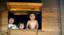 Chilean children look out from their one-room shanty. Chile is at the bottom of the OECD's income equality list. (Eliseo Fernandez/REUTERS)