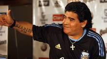 In this Jan. 25, 2010 file photo Argentina's soccer coach Diego Maradona gives a thumbs up to reporters during a press conference in San Juan, Argentina. The Argentine soccer star underwent surgery early Tuesday, March 30, 2010, after one of his dogs bit him in his upper lip. (AP Photo/Roberto Candia, File) (Roberto Candia)