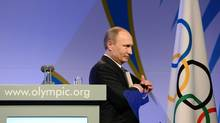 Russian President Vladimir Putin leaves the stage after delivering his speech at the IOC President's Gala Dinner on the eve of the opening ceremony of the 2014 Winter Olympics, Thursday, Feb. 6, 2014, in Sochi, Russia. (Andrej Isakovic/AP)