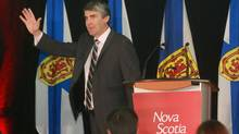 Nova Scotia Liberal Party Leader Stephen McNeil raises his hand in victory at his campaign headquarters in Bridgetown, N.S., on Oct. 8, 2013, after winning the Nova Scotia provincial election. (MIKE DEMBECK/THE CANADIAN PRESS)