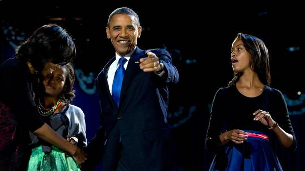 U.S. President Barack Obama arrives at the election night victory rally, accompanied by first lady Michelle Obama and daughters Malia and Sasha. (Carolyn Kaster/AP)