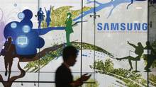 A man walks past a Samsung Electronics' advertisement in Seoul in this Oct. 5, 2012, file photo. Samsung is expected to unveil its Galaxy S IV at an event in New York on March 14. (KIM HONG-JI/REUTERS)