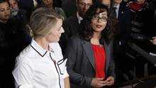 Liberal MP Iqra Khalid makes an announcement about an anti-Islamophobia motion on Parliament Hill while Minister of Canadian Heritage Melanie Joly looks on in Ottawa on Wednesday, Feb. 15, 2017. (PATRICK DOYLE/THE CANADIAN PRESS)