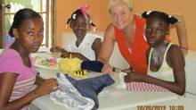Mireille Roy teaches woman and children how to sew in Haiti.