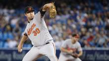 Chris Tillman of the Baltimore Orioles delivers a pitch during MLB action against the Toronto Blue Jays on Sept. 28, 2016. (Tom Szczerbowski/Getty Images)