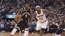 Toronto Raptors forward DeMarre Carroll, left, drives past Cleveland Cavaliers' Lebron James on Nov. 25, 2015. Carroll is out indefinitely after undergoing arthroscopic knee surgery. (Darren Calabrese/THE CANADIAN PRESS)