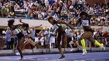 Nikkita Holder (left) defeats Priscilla Lopes-Schliep (back left), Phylicia George (centre) and Perdita Felicien (right) in the women's 100 metre hurdles at the Toronto International Track and Field Games in Toronto on Wednesday, July 11, 2012. (Frank Gunn/THE CANADIAN PRESS)