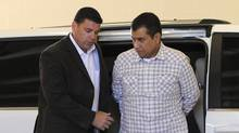 George Zimmerman (right) arrives at the John E. Polk Correctional Facility after his bond was revoked by a Florida judge in Sanford, Florida in this June 3, 2012 file photograph (Brian Blanco/Reuters)