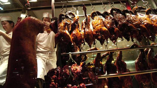 Various cooked meats hang in the window at King's Noodle Restaurant on Spadina Avenue in Toronto. </caption><cutline_leadin>deborah Baic