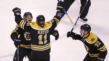 Boston Bruins right wing Jimmy Hayes (11) is congratulated after his third goal of the game by teammates Max Talbot and Frank Vatrano (72) during the third period of an NHL hockey game against the Ottawa Senators in Boston, Tuesday, Dec. 29, 2015. The Bruins defeated the Senators 7-3. (Charles Krupa/AP)