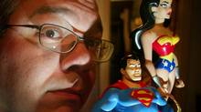 Writer Greg Rucka poses in his studio with action figures on Dec. 30, 2003, in Portland, Ore. (RICK BOWMER/Associated Press)