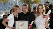 Director Abdellatif Kechiche, centre, with actors Léa Seydoux, left, and Adèle Exarchopoulos on May 26, 2013. Their film Blue is the Warmest Colour was awarded the Palme d'Or at this year's Cannes Film Festival. (Lionel Cironneau/AP)