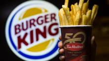 Burger King French fries stuffed into a Tim Hortons coffee cup outside a Burger King in Richmond, B.C., Aug. 26, 2014. (John Lehmann/The Globe and Mail)