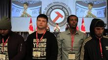 Dozens of delegates at a youth labour forum turned their backs Tuesday on Prime Minister Justin Trudeau. (Fred Chartrand/The Canadian Press)