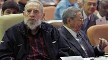 Former Cuban leader Fidel Castro, left, sites beside his brother, Cuban President Raul Castro, during the opening session of the National Assemby in Havana, Feb. 24, 2012. (Ismael Francisco/AP)