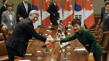 Canadian Prime Minister Stephen Harper, left, and South Korean President Park Geun-hye pose for photographers before their meeting at the presidential Blue House in Seoul on March 11, 2014. (Lee Jin-man/AP)