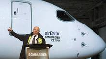"""Bombardier CEO Alain Bellemare speaks during a ceremony to mark the first delivery of Bombardier's CS300 to Air Baltic in Mirabel, Que., Monday, November 28, 2016. Bellemare says the company did """"a bad job"""" explaining its decision to raise executive compensation. THE CANADIAN PRESS/Graham Hughes (Graham Hughes/THE CANADIAN PRESS)"""