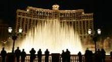 Tourists view the water show at the Bellagio Hotel & Casino on the 'strip' in Las Vegas, Nev.