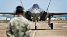 An F-35 Lightning II jet lands at Eglin Air Force Base in Florida on July 14, 2011. (Samuel King Jr./U.S. Air Force)