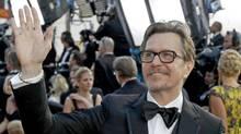 Gary Oldman arrives at the Oscar ceremony in Los Angeles, Feb. 26, 2012. (Chris Carlson / AP)