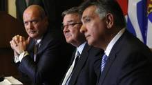 Finance Minister Jim Flaherty, centre, takes part in a news conference with Ontario Finance Minister Charles Sousa, right, and British Columbia Finance Minister Mike de Jong after signing an agreement to set up a cooperative capital markets regulator, in Ottawa Sept. 19, 2013. (CHRIS WATTIE/REUTERS)