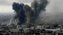 Smoke rises following an Israeli strike on smuggling tunnels along the border between Egypt and Rafah southern Gaza Strip, Nov. 21, 2012. (Eyad Baba/AP)