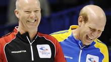 Alberta skip Kevin Martin laughs with Ontario skip Glenn Howard (L) during the 14th draw at the Brier curling championships in London, Ontario, March 10, 2011. (MARK BLINCH/REUTERS)