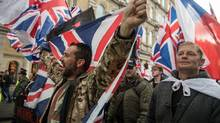 Protesters chant and wave British Union Jack flags during a protest titled 'London march against terrorism' in response to the March 22 Westminster terror attack on April 1, 2017 in London, England. The march has been organised by far right groups English Defence League and Britain First, which also sees a counter-protest held by group 'Unite Against Fascism'. During the terror attack in Westminster, Khalid Masood killed 4 people as he drove a car into pedestrians over Westminster Bridge and stabbed PC Keith Palmer to death before being shot dead himself. (Chris J Ratcliffe/Getty Images)
