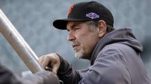 San Francisco Giants manager Bruce Bochy watches over a voluntary workout in preparation for Sunday's Game 6 of the National League championship baseball series against the St. Louis Cardinals, Saturday, Oct. 20, 2012, in San Francisco. (Ben Margot/The Associated Press)