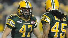 Edmonton Eskimos' JC Sherritt, celebrates getting the CFL record for most tackles in a season against the Calgary Stampeders during second half CFL football action at Commonwealth Stadium in Edmonton on Nov. 2, 2012. The linebacker is out indefinitely after re-fracturing his left thumb. (Ian Jackson/THE CANADIAN PRESS)