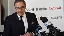 Martin Cauchon, of the Groupe Capitales Media, announces the purchase of six newspapers that were owned by Gesca, on March 18, 2015. (Jacques Boissinot/The Canadian Press)