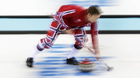Norway's Torger Nergaard sweeps the ice during the men's curling training session at the 2014 Winter Olympics, Sunday, Feb. 9, 2014, in Sochi, Russia.