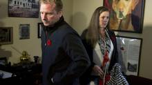 Afghanistan veteran Shane Jones, who suffers from post-traumatic stress disorder and was medically discharged from the military after sustaining a severe brain injury, heads from a news conference with his wife, Veronica, in Fall River, N.S., on Nov. 4, 2013. (ANDREW VAUGHAN/THE CANADIAN PRESS)