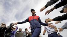 Dustin Johnson touts his poor memory – ignoring past meltdowns to focus on winning what's in front of him – as a great asset, and the American Ryder Cup team could use some of that 'short memory' to forget some embarrassing defeats. (Charlie Riedel/AP)