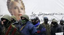 Anti-government protesters march on a street in front a banner with portrait of opposition leader Yulia Tymoshenko in central Kiev February 8, 2014. President Viktor Yanukovych suffered a huge setback when Ukraine's parliament voted 310 to zero to free former prime minister Yulia Tymoshenko from prison. (Gleb Garanich/Reuters)