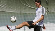 Germany's national soccer player Mario Gomez kicks the ball during a training session in Gdansk, June 19, 2012, ahead of their Euro 2012 match against Greece on June 22. (THOMAS BOHLEN/REUTERS)