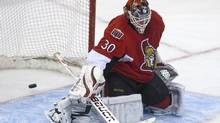 Ottawa Senators goaltender Brian Elliott lets a shot past him during second period NHL hockey action against the Calgary Flames in Ottawa on Friday Jan. 14. (Pawel Dwulit)
