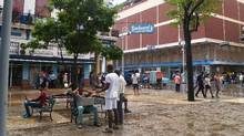 In June, Cuba's state-owned telecommunications monopoly cut the price of Internet access in half and opened dozens of new WiFi access points in parks and public squares across the country. (Stephanie Shumsky,)